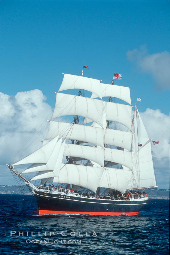Image 07785, The Star of India under full sail offshore of San Diego. The Star of India is the worlds oldest seafaring ship.  Built in 1863, she is an experimental design of iron rather than wood.  She is now a maritime museum docked in San Diego Harbor, and occasionally puts to sea for special sailing events. San Diego, California, USA, Phillip Colla, all rights reserved worldwide. Keywords: boat, california, historical, marine, maritime, ocean, offshore, outdoors, outside, sail, sailboat, sailing, sailor, san diego, sea, ship, star of india, usa, voyage, water.