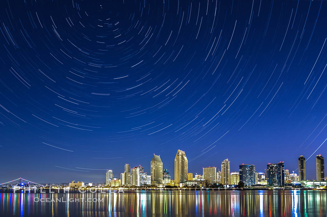 Star Trails over the San Diego Downtown City Skyline.  In this 60 minute exposure, stars create trails through the night sky over downtown San Diego. California, USA, natural history stock photograph, photo id 28383