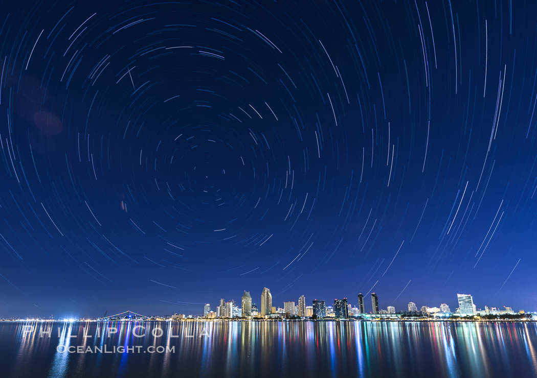 Star Trails over the San Diego Downtown City Skyline.  In this 60 minute exposure, stars create trails through the night sky over downtown San Diego. California, USA, natural history stock photograph, photo id 28385
