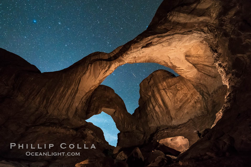 Stars and Iridium Flare over Double Arch, Arches National Park. Utah, USA, natural history stock photograph, photo id 29250