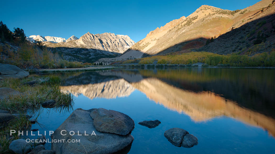 Sunrise on Paiute Peak, reflected in North Lake in the eastern Sierra Nevada, in autumn. Bishop Creek Canyon Sierra Nevada Mountains, California, USA, natural history stock photograph, photo id 26058