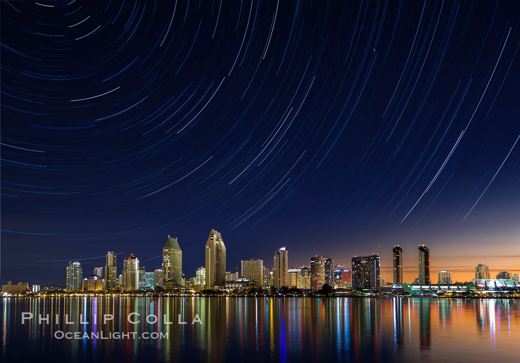 Approaching sunrise and star trails over the San Diego Downtown City Skyline.  In this 60 minute exposure, stars create trails through the night sky over downtown San Diego. San Diego, California, USA, natural history stock photograph, photo id 28386