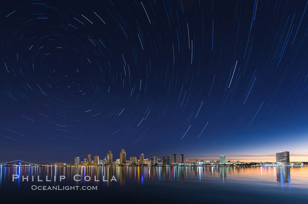 Approaching sunrise and star trails over the San Diego Downtown City Skyline.  In this 60 minute exposure, stars create trails through the night sky over downtown San Diego. San Diego, California, USA, natural history stock photograph, photo id 28388