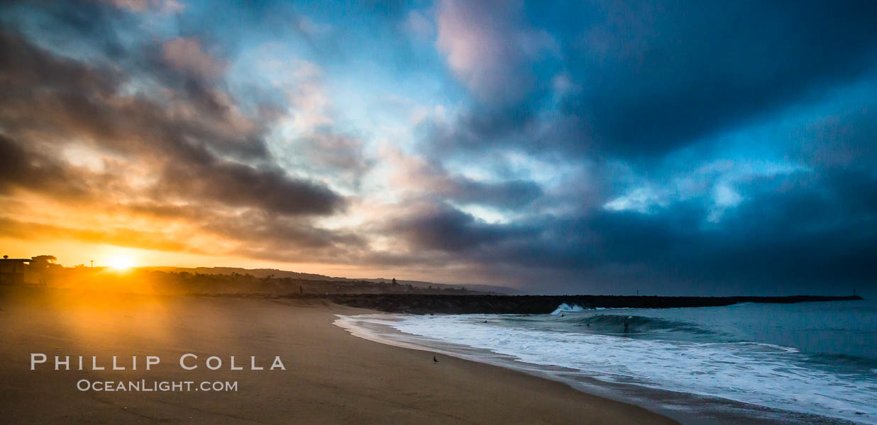 Sunrise at the Wedge.  The Wedge, a notorious and famous shorebreak at the end of the Newport Peninsula, is seen here under a huge dawning sky and sporting a small but fun swell. The Wedge, Newport Beach, California, USA, natural history stock photograph, photo id 27991