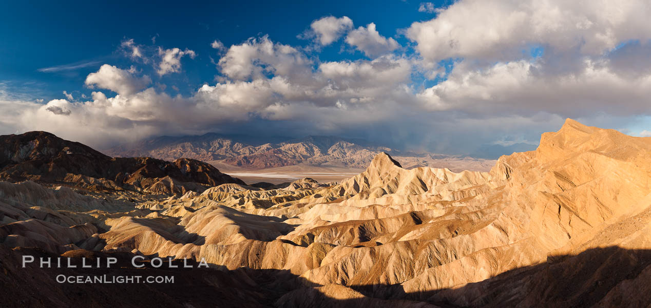 Sunrise at Zabriskie Point, Manly Beacon is lit by the morning sun while clouds from a clearing storm pass by. Death Valley National Park, California, USA, natural history stock photograph, photo id 27658