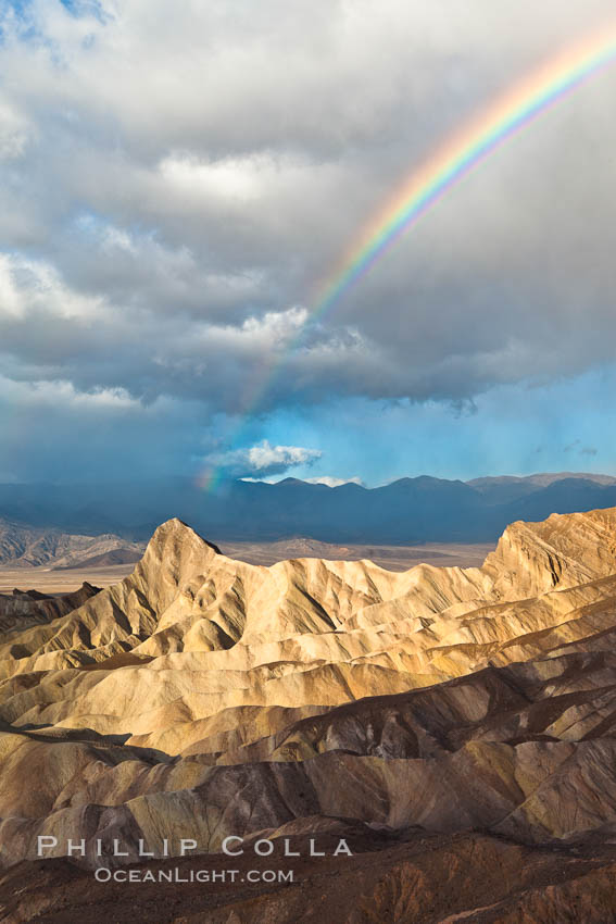 Sunrise at Zabriskie Point, Manly Beacon is lit by the morning sun while clouds from a clearing storm pass by. Death Valley National Park, California, USA, natural history stock photograph, photo id 27661