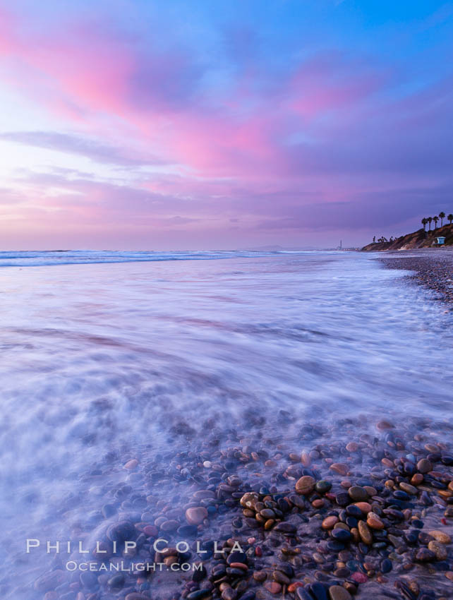 Sunset and incoming surf, gorgeous colors in the sky and on the ocean at dusk, the incoming waves are blurred in this long exposure. Carlsbad, California, USA, natural history stock photograph, photo id 27168