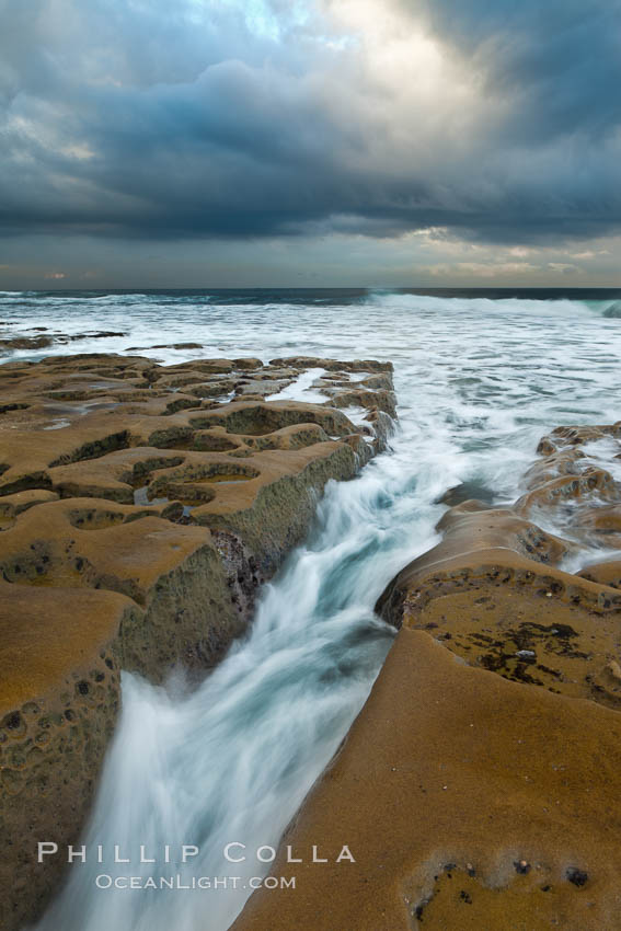 Waves wash over sandstone reef, clouds and sky. La Jolla, California, USA, natural history stock photograph, photo id 26338
