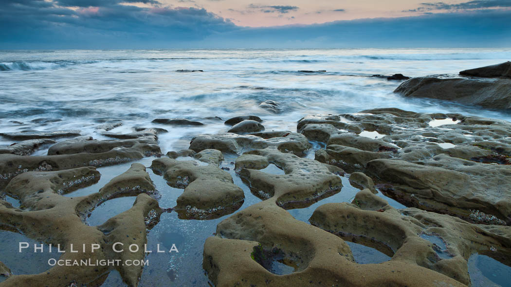 Waves wash over sandstone reef, clouds and sky. La Jolla, California, USA, natural history stock photograph, photo id 26346