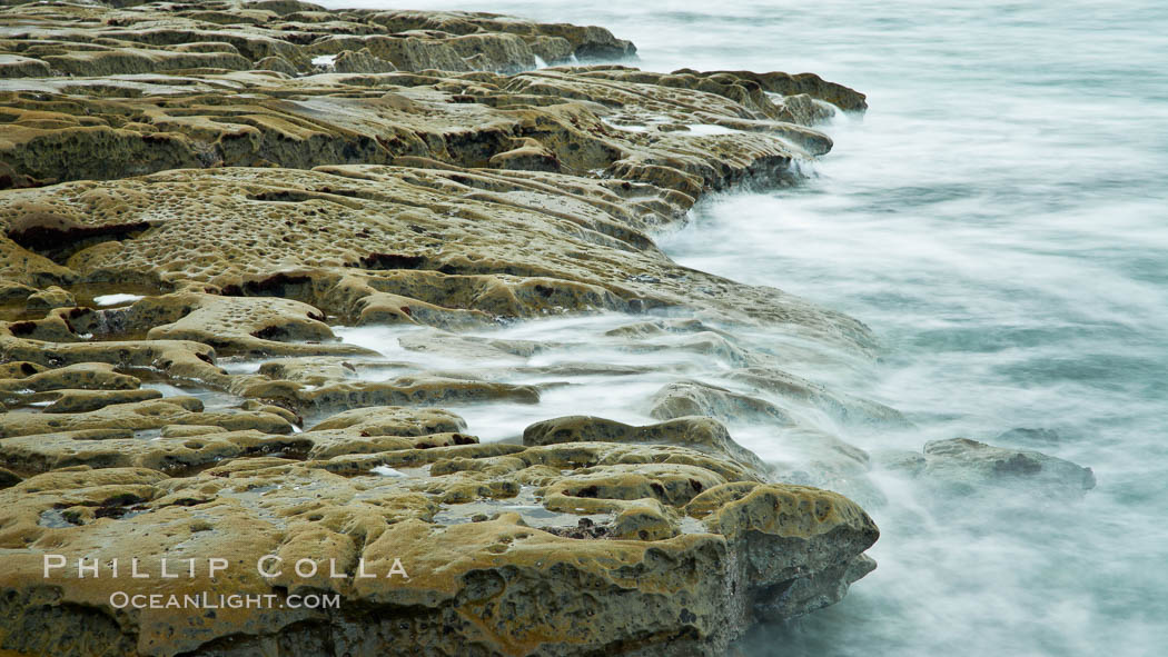 Waves wash over sandstone reef, clouds and sky. La Jolla, California, USA, natural history stock photograph, photo id 26345