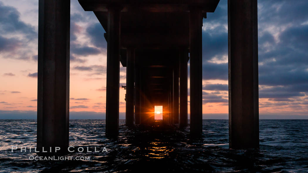 Scripps Pier solstice, surfer's view from among the waves, sunset aligned perfectly with the pier. Research pier at Scripps Institution of Oceanography SIO, sunset. La Jolla, California, USA, natural history stock photograph, photo id 30150