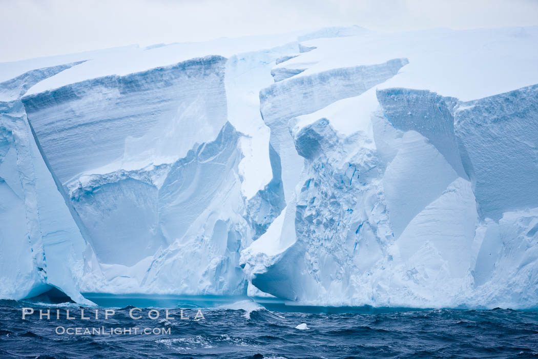Image 24793, Tabular iceberg.  The edge of a huge tabular iceberg.  Tabular icebergs can be dozens or hundreds of miles in size, have flat tops and sheer sides. Scotia Sea, Southern Ocean