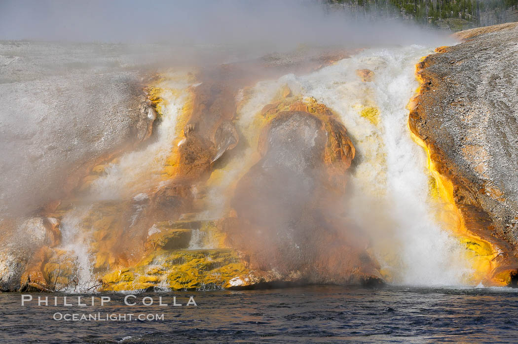 Thermophilac heat-loving bacteria color the runoff canals from Excelsior Geyser as it empties into the Firehole River. Midway Geyser Basin, Yellowstone National Park, Wyoming, USA, natural history stock photograph, photo id 13596