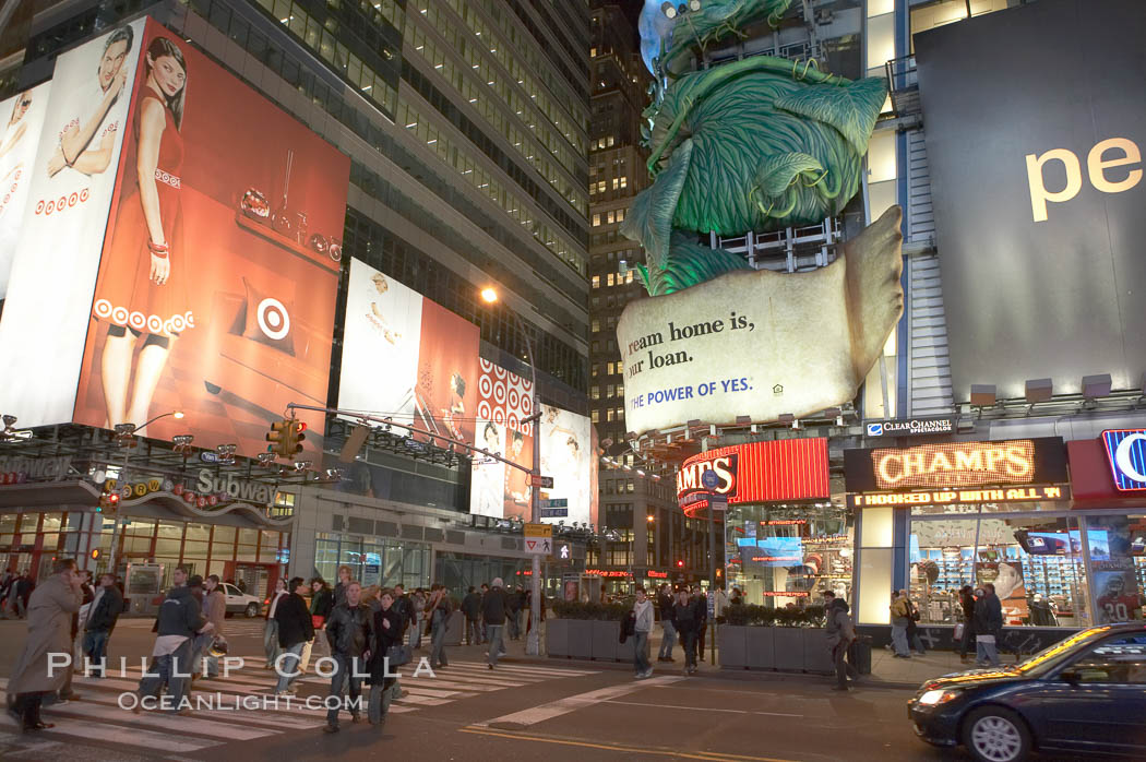 Neon lights fill Times Square at night. New York City, USA, natural history stock photograph, photo id 11211