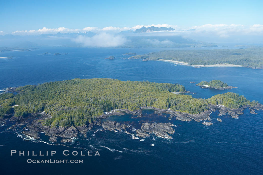 Blunden Island (foreground) and Vargas Island (distance), surrounded by the waters of Clayoquot Sound, west coast of Vancouver Island. Tofino, British Columbia, Canada, natural history stock photograph, photo id 21080