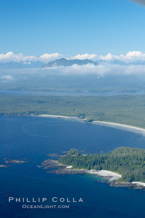 Image 21097, Ahouse Bay and Vargas Island, aerial photo, Clayoquot Sound in the foreground, near Tofino on the west coast of Vancouver Island. Tofino, British Columbia, Canada, Phillip Colla, all rights reserved worldwide. Keywords: aerial, aerial photo, british columbia, canada, clayoquot sound, clayoquot sound unesco biosphere reserve, international, landscape, marine, nature, ocean, outdoors, outside, provincial parks, scene, scenic, threatened, tofino, vancouver island, vargas island, vargas island provincial marine park, vargas island provincial park, vargas provincial park.
