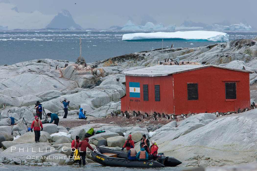 Image 25619, Tourists land on Peterman Island, near the Argentine research hut. Peterman Island, Antarctic Peninsula, Antarctica, Phillip Colla, all rights reserved worldwide. Keywords: antarctic peninsula, antarctica, oceans, peterman island, petermann island, southern ocean.