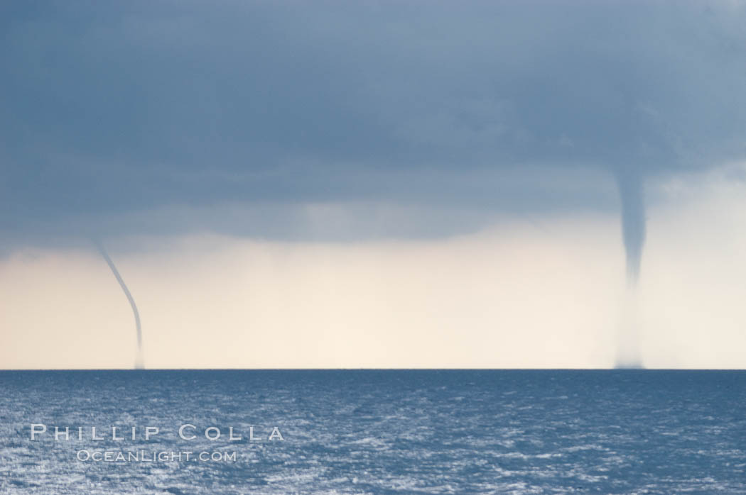 Image 10854, Two simultaneous waterspouts.  Waterspouts are tornadoes that form over water. Great Isaac Island, Bahamas, Phillip Colla, all rights reserved worldwide. Keywords: atlantic, bahamas, great isaac island, oceans, waterspout, weather.