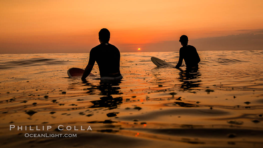 Two surfers at sunset, blood red dusk, Encinitas. California, USA, natural history stock photograph, photo id 27976