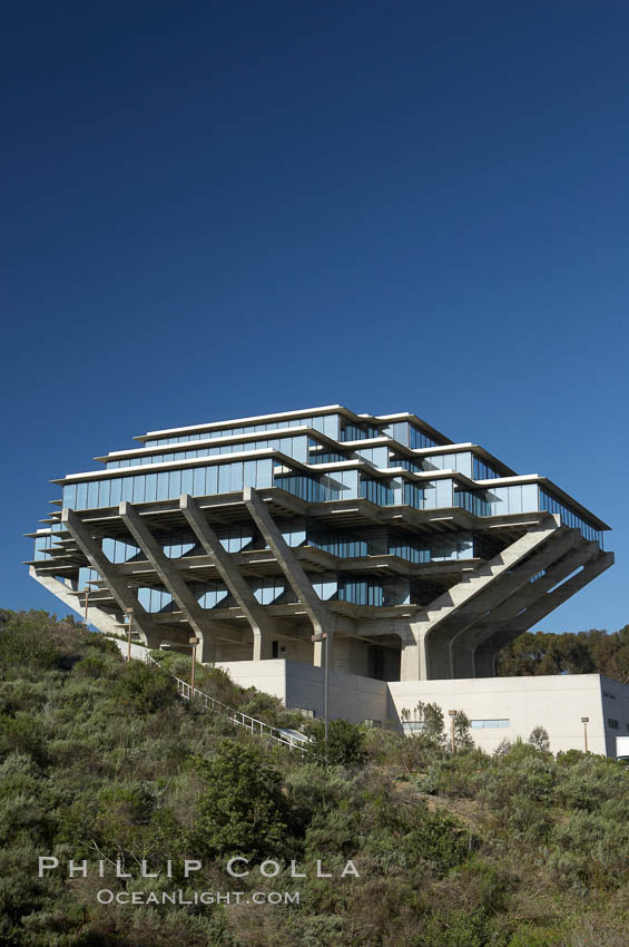 The UCSD Library (Geisel Library, UCSD Central Library) at the University of California, San Diego.  UCSD Library.  La Jolla, California.  On December 1, 1995 The University Library Building was renamed Geisel Library in honor of Audrey and Theodor Geisel (Dr. Seuss) for the generous contributions they have made to the library and their devotion to improving literacy.  In The Tower, Floors 4 through 8 house much of the Librarys collection and study space, while Floors 1 and 2 house service desks and staff work areas.  The library, designed in the late 1960s by William Pereira, is an eight story, concrete structure sited at the head of a canyon near the center of the campus. The lower two stories form a pedestal for the six story, stepped tower that has become a visual symbol for UCSD. USA, natural history stock photograph, photo id 11276