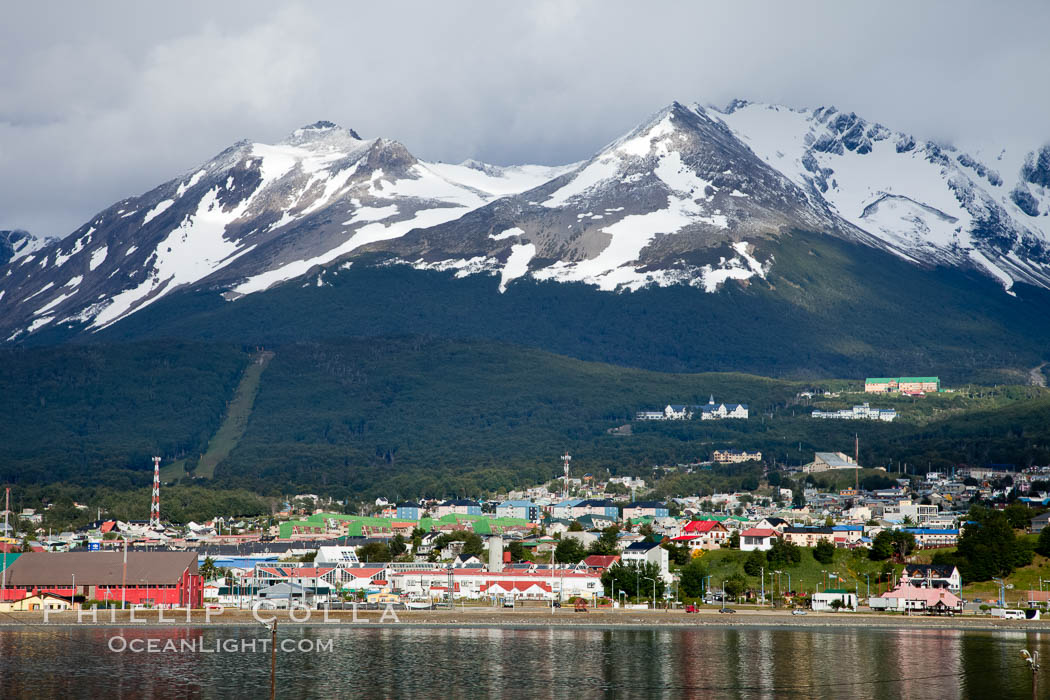 Ushuaia, the southernmost city in the world, lies on the Beagle Channel with a small portion of the Andes mountain range rising above.  Ushuaia is the capital of the Tierra del Fuego region of Argentina and the gateway port for many expeditions to Antarctica., natural history stock photograph, photo id 23602