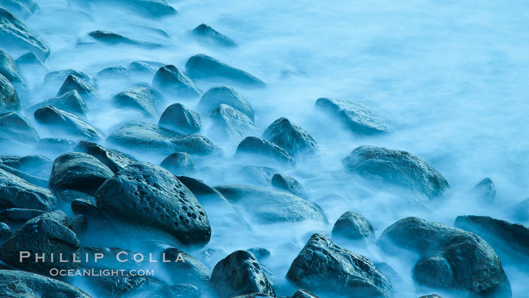 Image 26451, Waves and beach boulders, abstract study of water movement. La Jolla, California, USA, Phillip Colla, all rights reserved worldwide. Keywords: abstract, beach, blur, boulder, cobble stones, marine, mist, ocean, sea, seasmoke, wave.