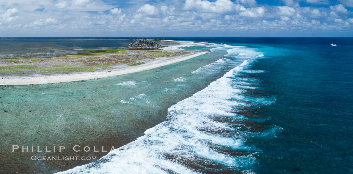 Waves break on the coral reef and wash ashore at Clipperton Island, aerial photo. Clipperton Island, a minor territory of France also known as Ile de la Passion, is a spectacular coral atoll in the eastern Pacific. By permit HC / 1485 / CAB (France). Clipperton Island, France, natural history stock photograph, photo id 32832