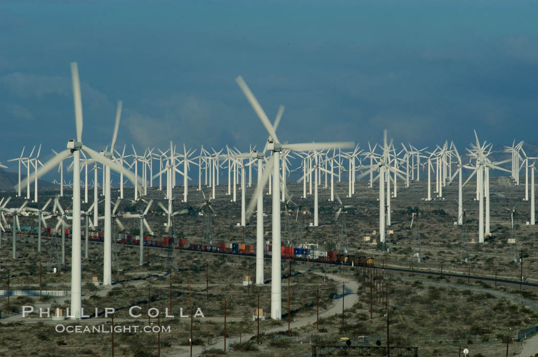 Image 06863, Wind turbines provide electricity to Palm Springs and the Coachella Valley. San Gorgonio pass, San Bernardino mountains. San Gorgonio Pass, Palm Springs, California, USA, Phillip Colla, all rights reserved worldwide. Keywords: california, coachella valley, desert, electricity, energy, palm springs, power generation, san gorgonio pass, san gorgonio pass wind farm, science and technology, usa, wind farm, wind power, wind turbine, windmill.