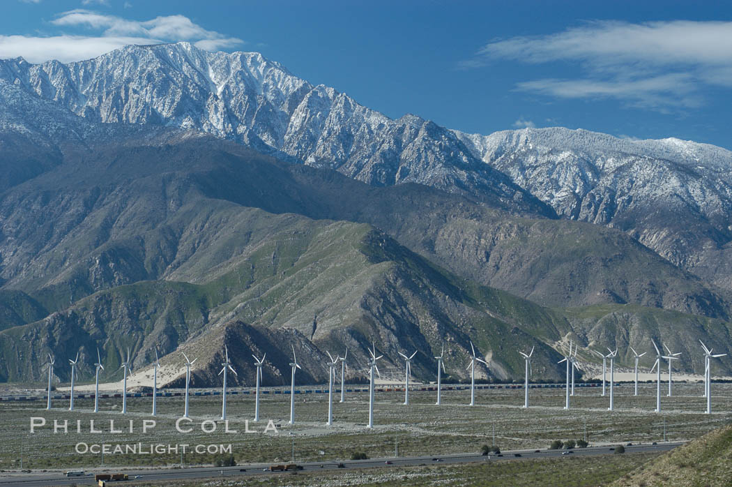 Wind turbines overlooking Interstate 10 provide electricity to Palm Springs and the Coachella Valley. San Gorgonio pass, San Bernardino mountains. San Gorgonio Pass, Palm Springs, California, USA, natural history stock photograph, photo id 06853