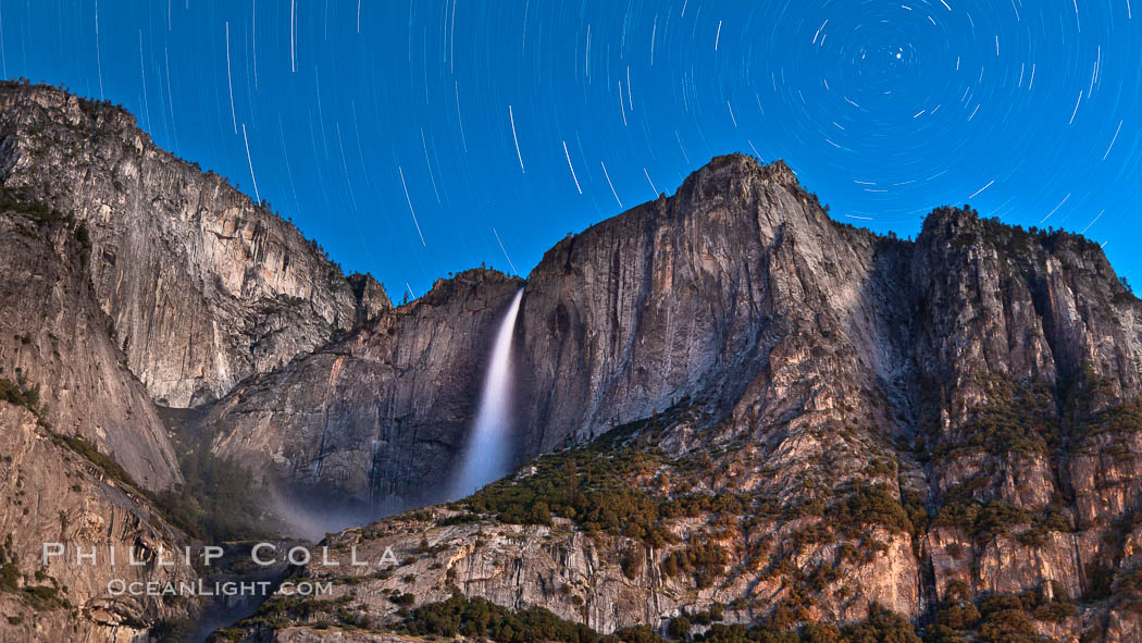 Yosemite Falls and star trails, night sky time exposure of Yosemite Falls waterfall in full spring flow, with star trails arcing through the night sky. Yosemite National Park, California, USA, natural history stock photograph, photo id 26853