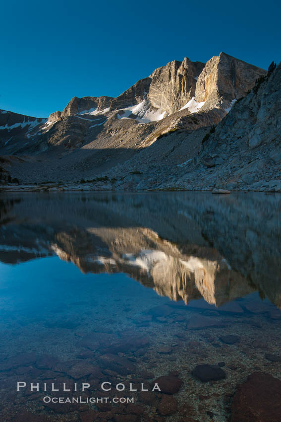 Cathedral Range peaks reflected in the still waters of Townsley Lake at sunrise. Yosemite National Park, California, USA, natural history stock photograph, photo id 25781