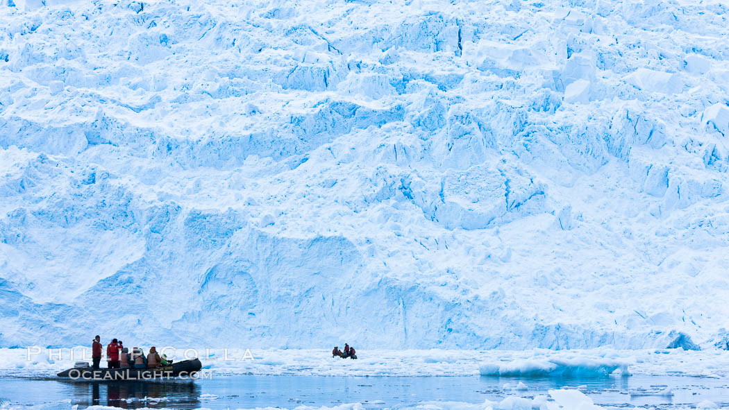 Zodiac cruising in Antarctica.  Tourists enjoy the pack ice and towering glaciers of Cierva Cove on the Antarctic Peninsula., natural history stock photograph, photo id 25590