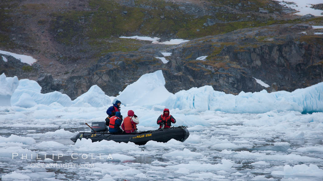 Image 25564, Zodiac cruising in Antarctica.  Motoring in an inflatable zodiac through pack ice along the Antarctic Peninsula. Cierva Cove, Phillip Colla, all rights reserved worldwide. Keywords: antarctic peninsula, antarctica, cierva cove, oceans, southern ocean.
