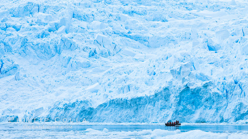 Zodiac cruising in Antarctica.  Tourists enjoy the pack ice and towering glaciers of Cierva Cove on the Antarctic Peninsula. Cierva Cove, Antarctic Peninsula, Antarctica, natural history stock photograph, photo id 25591