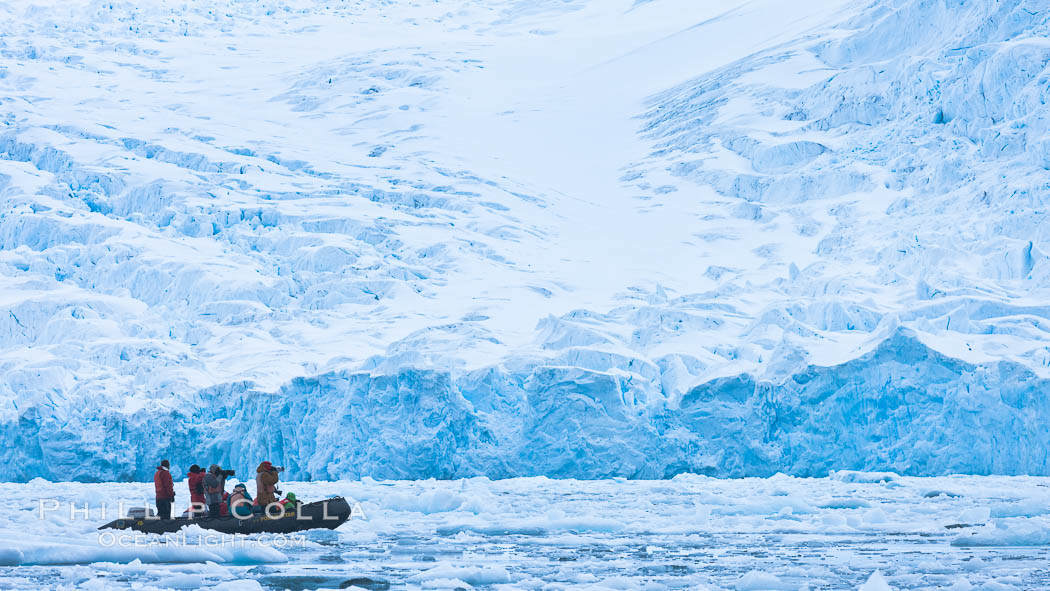 Zodiac cruising in Antarctica.  Tourists enjoy the pack ice and towering glaciers of Cierva Cove on the Antarctic Peninsula., natural history stock photograph, photo id 25529